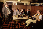 Local men sing traditional songs and recite stories and poetry. Kings Head Laxfield Suffolk 1980s