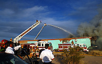 5:30 pm 200 yards southeast of Park and Broadway Tucson Fire Department arrives and begin to lay lines and get water to the fire..