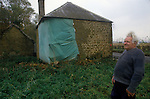 Great Tew Oxfordshire 1986. Local resident Frank Salt who lives n the Toll House. Rxterior Toll House showing damage.