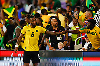 July 16th 2021; Orlando, Florida, USA; Jamaica defender Liam Moore celebrates with a fan following the Concacaf Gold Cup match between Guadeloupe and Jamaica on July 16, 2021 at Exploria Stadium in Orlando, Fl.