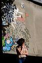 Paris, France. 09.05.2015. Woman smoking in Monmartre. Photograph © Jane Hobson