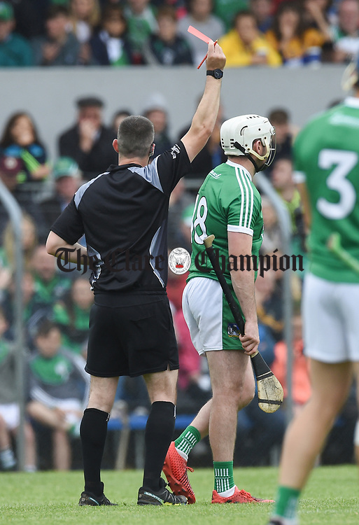 Referee James Owens sends off Tom Condon of Limerick during their Munster championship game in Ennis. Photograph by John Kelly.