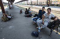 Migrants waiting at the train station in Belgrade<br />