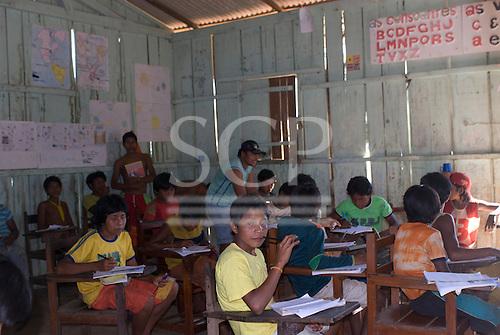 Pará State, Brazil. Aldeia Kokraimoro (Kayapo). Children studying in the village school.