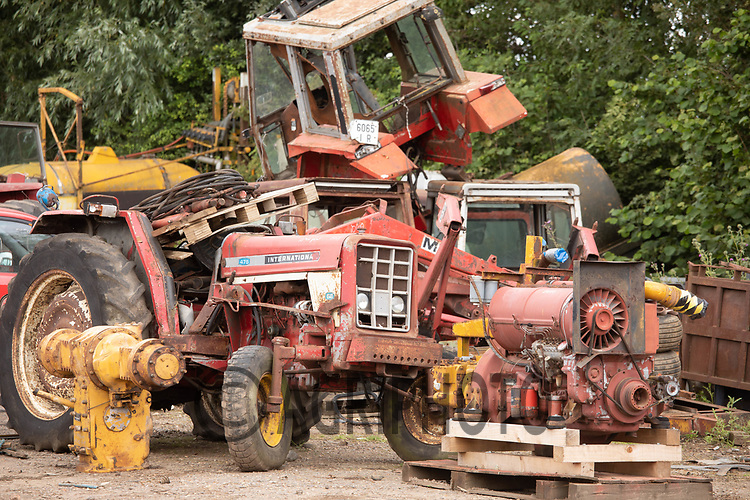 Used tractors in Cambridge Machinery Sales waiting to be packed in containers <br /> ©Tim Scrivener Photographer 07850 303986<br />      ....Covering Agriculture In The UK....