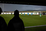 Holker Old Boys 2 Crook Town 1, 10/10/2020. Rakesmoor, FA Vase second round qualifying. Two spectators watching the first-half action as Holker Old Boys (in green) take on Crook Town in an FA Vase second round qualifying tie at Rakesmoor, Barrow-in-Furness. The home club was established in 1936 as Holker Central Old Boys and was initially an under-16 team for former pupils of the Holker Central Secondary School. Holker from the North West Counties League beat their Northern League opponents 2-1, watched by a crowd of 147 spectators. Photo by Colin McPherson.