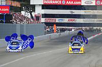 Nov. 13, 2011; Pomona, CA, USA; NHRA funny car driver Ron Capps (right) alongside Robert Hight during the Auto Club Finals at Auto Club Raceway at Pomona. Mandatory Credit: Mark J. Rebilas-.