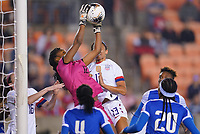 HOUSTON, TX - JANUARY 28: Kerly Theus #12 GK for Haiti leaps high to save a ball during a game between Haiti and USWNT at BBVA Stadium on January 28, 2020 in Houston, Texas.