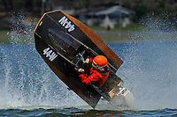Frame 7: Bruce Hansen (44-W) blows over in a turn then turns upright after landing.....Stock  Outboard Winter Nationals, Ocoee, Florida, USA.13/14 March, 2010 © F.Peirce Williams 2010