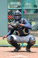 GCL Braves catcher Anthony Nunez #71 warms up a pitcher in the bullpen during a game against the GCL Pirates at Disney Wide World of Sports on June 25, 2011 in Kissimmee, Florida.  The Pirates defeated the Braves 5-4 in ten innings.  (Mike Janes/Four Seam Images)