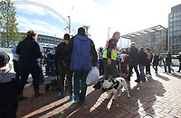 A handler and Explosive Search Dog perform bag searches on Wembley Way prior to kick off of the Premier League match between Tottenham Hotspur and Swansea City at Wembley Stadium, London, England, UK. Saturday 16 September 2017