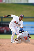 Fort Myers Miracle shortstop Engelb Vielma (7) tags out Amed Rosario (11) during a game against the St. Lucie Mets on April 19, 2015 at Hammond Stadium in Fort Myers, Florida.  Fort Myers defeated St. Lucie 3-2 in eleven innings.  (Mike Janes/Four Seam Images)
