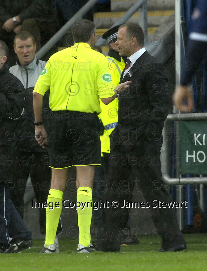 24/11/2007      Copyright Pic: James Stewart.File Name : sct_jspa25_falkirk_v_rangers.FALKIRK MANAGER JOHN HUGHES GETS A LECTURE FROM THE REF....James Stewart Photo Agency 19 Carronlea Drive, Falkirk. FK2 8DN      Vat Reg No. 607 6932 25.Office     : +44 (0)1324 570906     .Mobile   : +44 (0)7721 416997.Fax         : +44 (0)1324 570906.E-mail  :  jim@jspa.co.uk.If you require further information then contact Jim Stewart on any of the numbers above.........