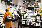 Shoppers look at the discography of David Bowie on sale at Tower Records in Shibuya on January 12, 2016, Tokyo, Japan. Tower Records created a special section for the British singer, songwriter and actor David Bowie, who died of cancer at the age of 69 on January 10, 2016. His recently released album Blackstar is now sold out in Japan. (Photo by Rodrigo Reyes Marin/AFLO)