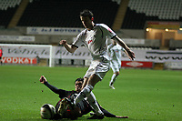 Pictured: Stephen O'Halloran of Swansea (R) crosses the bal while Hugo Colase of Barnsley tries to tackle him (L)<br /> Re: Coca Cola Championship, Swansea City FC v Barnsley at the Liberty Stadium. Swansea, south Wales, Tuesday 09 December 2008.<br /> Picture by D Legakis Photography / Athena Picture Agency, Swansea 07815441513