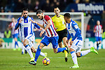 Yannick Ferreira Carrasco (c) of Atletico de Madrid vies for the ball with Deportivo Leganes' players during their La Liga match between Atletico de Madrid and Deportivo Leganes at the Vicente Calderón Stadium on 04 February 2017 in Madrid, Spain. Photo by Diego Gonzalez Souto / Power Sport Images