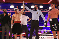 19th December 2020, Hamburg, Germany; Universal Boxing Promotion fight, Felix Sturm versus Timo Rost; The referee raises the arm of Rost after a unanimous victory