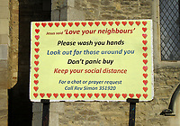 "St Marys Church in Goldington, Bedford, UK has sign outside encouraging people to 'Wash your Hands, Dont Panic Buy, Keep to Social Distance and Love Your Neighbours"" as the Coronavirus (Covid 19) pandemic accelerates in the UK. March 23rd 2020<br /> <br /> Photo by Keith Mayhew"