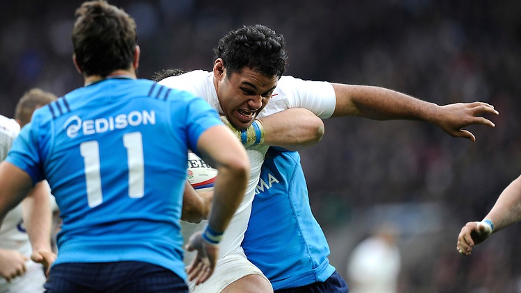 Billy Vunipola of England fis tackled by Edoardo Gori of Italy during the RBS 6 Nations match between England and Italy at Twickenham Stadium on Saturday 14th February 2015 (Photo by Rob Munro)