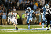 CHAPEL HILL, NC - NOVEMBER 02: Michael Carter #8 of the University of North Carolina runs the ball during a game between University of Virginia and University of North Carolina at Kenan Memorial Stadium on November 02, 2019 in Chapel Hill, North Carolina.