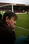 Kidderminster Harriers 3 Gainsborough Trinity 0, 19/11/2016. Aggborough, National League North. A home fan keeping an eye on the action at Aggborough, home of Kidderminster Harriers as they played visitors Gainsborough Trinity in a National League North fixture. Harriers were formed in 1886 and have played at their current home since 1890. They won this match  by 3-0 watched by a crowd of 1465. Photo by Colin McPherson.