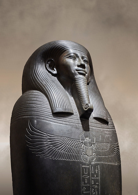 Ancient Egyptian greywacke sarcophagus of Vizier Gemenefherbak - late Period, 26th Dynasty (664-525BC). Egyptian Museum, Turin. <br /> <br /> Gemenefherbak was a vizier, minister, as indicated by a pendant picturing the goddess Maat hanging around his neck in the shadow of his beard. Despite the hardness of the greywacke stone the sarcophagus is made from, its makers have shown incredible skill creating a sarcophagus with intricate detail and a highly polished finish.
