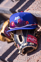 Iowa Cubs hat and glove sit on the dugout steps during a game against the Oklahoma City Dodgers at Chickasaw Bricktown Ballpark on April 9, 2016 in Oklahoma City, Oklahoma.  Oklahoma City defeated Iowa 12-1 (William Purnell/Four Seam Images)