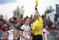Boyds, MD - Saturday May 07, 2016: Portland Thorns FC defender Emily Sonnett (16) receives a yellow card from referee Christopher Spivey during a regular season National Women's Soccer League (NWSL) match at Maureen Hendricks Field, Maryland SoccerPlex. Washington Spirit tied the Portland Thorns 0-0.
