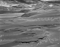 """""""Textures of the Sand"""" <br /> Great Sand Dunes National Park, Colorado<br /> <br /> The Great Sand Dunes National Park in Colorado is a wonderful place, indeed. The dune field covers more than 330 square miles at elevations above 8,000 feet. Mountain peaks higher than 14,000 feet add even more beauty to the area. This photo shows splendid textures in the dunes that vary from individual grains of sand in the foreground (probably not visible in this tiny web image) to large complex shapes produced by the combined actions of many forces in the dune field. The size of the scene can be appreciated by noting several people near the upper left corner of the image."""