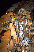 Rio de Janeiro, Brazil. Man in white, silver and gold carnival costume with zebra motif at the Scala ball.