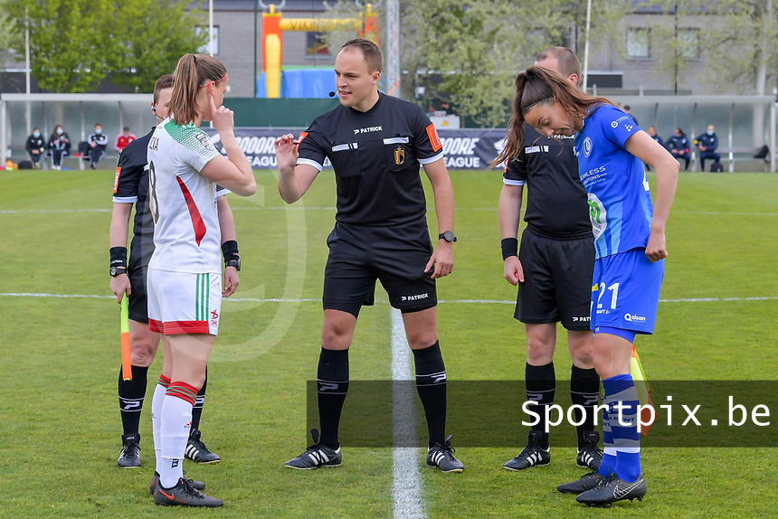 Lenie Onzia (8) of OHL , referee Florian Stove , Silke Vanwynsberghe (21) of AA Gent pictured before a female soccer game between AA Gent Ladies and Oud Heverlee Leuven on the fourth matchday of play off 1 in the 2020 - 2021 season of Belgian Scooore Womens Super League , saturday 1 st of May 2021  in Oostakker , Belgium . PHOTO SPORTPIX.BE | SPP | STIJN AUDOOREN