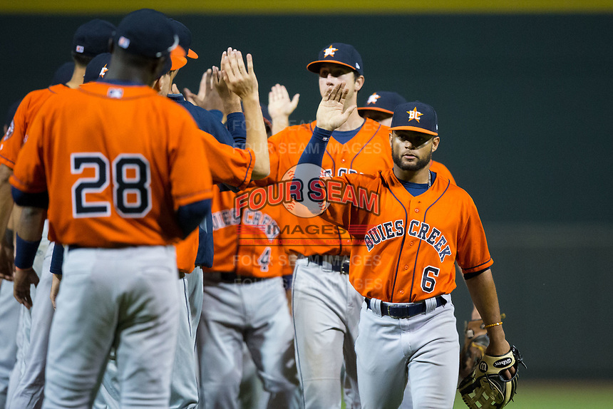 Jason Martin (6) of the Buies Creek Astros high fives his teammates following their win over the Winston-Salem Dash at BB&T Ballpark on April 15, 2017 in Winston-Salem, North Carolina.  The Astros defeated the Dash 13-6.  (Brian Westerholt/Four Seam Images)