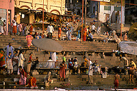 India, Uttar Pradesh, Varanasi, Ganges River, ghats & early morning bathers.<br />