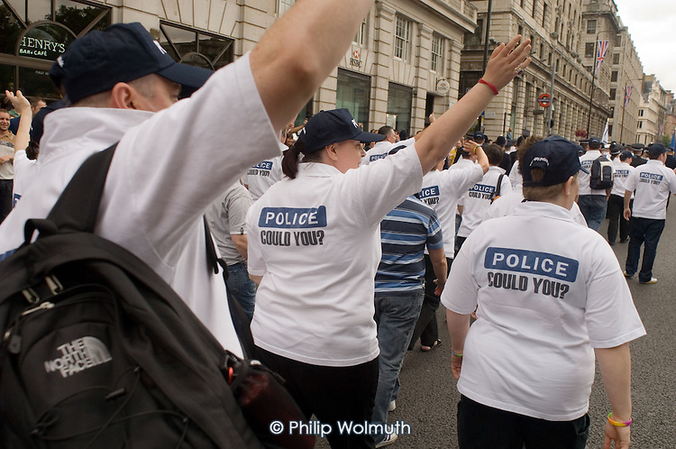 Police in uniform join the 2005 London Gay Pride parade.