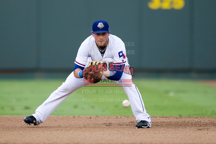 Round Rock Express first baseman Chris McGuiness (21) fields a ground ball during the Pacific Coast League baseball game against the Salt Lake Bees on August 10, 2013 at the Dell Diamond in Round Rock, Texas. Round Rock defeated Salt Lake 9-6. (Andrew Woolley/Four Seam Images)