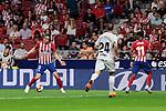 Atletico de Madrid's Filipe Luis (L) and Thomas Lemar (R) and SD Huesca's Jorge Miramon during La Liga match between Atletico de Madrid and SD Huesca at Wanda Metropolitano Stadium in Madrid, Spain. September 25, 2018. (ALTERPHOTOS/A. Perez Meca)