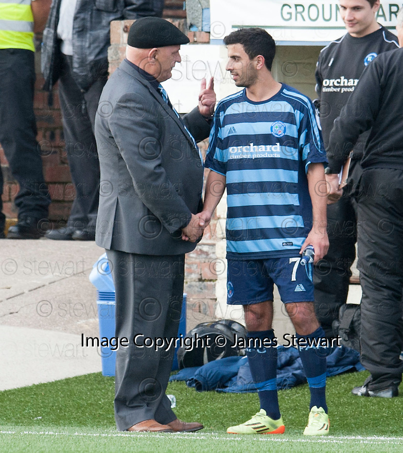 Forfar manager Dick Campbell has a word with Omar Kader after substituting him.