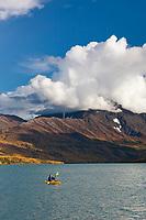 Kayakers Sonny and Claire Bartlett, enjoy an autumn day on Eklutna lake, Eklutna lake state park, just north of Anchorage, Alaska.
