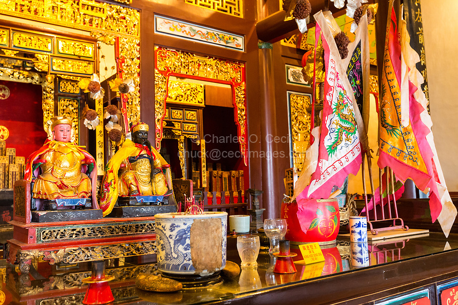 George Town, Penang, Malaysia.  Flags and Offerings to Deities in Cheah Kongsi, a Hokkien Clan Association Temple and Clan House.