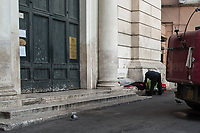 """Homeless Person.<br /> <br /> Rome, 12/03/2020. Documenting Rome under the Italian Government lockdown for the Outbreak of the Coronavirus (SARS-CoV-2 - COVID-19) in Italy. On the evening of the 11 March 2020, the Italian Prime Minister, Giuseppe Conte, signed the March 11th Decree Law """"Step 4 Consolidation of 1 single Protection Zone for the entire national territory"""" (1.). The further urgent measures were taken """"in order to counter and contain the spread of the COVID-19 virus"""" on the same day when the WHO (World Health Organization, OMS in Italian) declared the coronavirus COVID-19 as a pandemic (2.).<br /> ISTAT (Italian Institute of Statistics) estimates that in Italy there are 50,724 homeless people. In Rome, around 20,000 people in fragile condition have asked for support. Moreover, there are 40,000 people who live in a state of housing emergency in Rome's municipality.<br /> March 11th Decree Law (1.): «[…] Retail commercial activities are suspended, with the exception of the food and basic necessities activities […] Newsagents, tobacconists, pharmacies and parapharmacies remain open. In any case, the interpersonal safety distance of one meter must be guaranteed. The activities of catering services (including bars, pubs, restaurants, ice cream shops, patisseries) are suspended […] Banking, financial and insurance services as well as the agricultural, livestock and agri-food processing sector, including the supply chains that supply goods and services, are guaranteed, […] The President of the Region can arrange the programming of the service provided by local public transport companies […]».<br /> Updates: on the 12.03.20 (6:00PM) in Italy there 14.955 positive cases; 1,439 patients have recovered; 1,266 died.<br /> <br /> Footnotes & Links:<br /> Info about COVID-19 in Italy: http://bit.do/fzRVu (ITA) - http://bit.do/fzRV5 (ENG)<br /> 1. March 11th Decree Law http://bit.do/fzREX (ITA) - http://bit.do/fzRFz (ENG)<br /> 2. http://bit.do/fzRKm"""