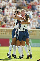 Shannon Boxx, left, Abby Wambach, center, and Brandi Chastain, right, celebrate a goal, USWNT vs. Mexico, September 7, 2003.