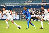 KANSASCITY, KS - JULY 11: Romario Barthelery #22 of Martinique with the ball during a game between Canada and Martinique at Children's Mercy Park on July 11, 2021 in KansasCity, Kansas.