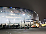 The Dallas Cowboys stadium shines in the night after the Thanksgiving Day game between the Miami Dolphins and the Dallas Cowboys at the Cowboys Stadium in Arlington, Texas. Dallas defeats Miami 20 to 19...
