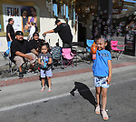 Annalissa and Aaliyah play with bubbles before the Reno Rodeo Parade on Saturday, June 22, 2019.