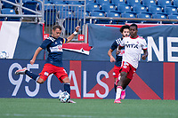 FOXBOROUGH, MA - JUNE 26: Jake Rozhansky #32 of the New England Revolution crosses the ball during a game between North Texas SC and New England Revolution II at Gillette Stadium on June 26, 2021 in Foxborough, Massachusetts.
