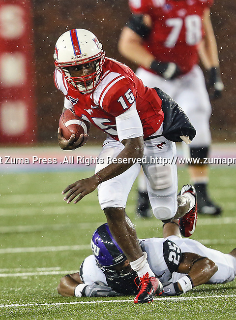 Southern Methodist Mustangs wide receiver Jeremy Johnson (15) and TCU Horned Frogs cornerback Kevin White (25) in action during heavy rainfall in the game between the Southern Methodist Mustangs and the TCU Horned Frogs at the Gerald J. Ford Stadium in Dallas, Texas. TCU defeats SMU 24 to 16..