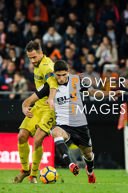 Mario Gaspar Perez Martinez of Villarreal CF (L) fights for the ball with GonCalo Manuel Ganchinho Guedes of Valencia CF  (R) during the La Liga 2017-18 match between Valencia CF and Villarreal CF at Estadio de Mestalla on 23 December 2017 in Valencia, Spain. Photo by Maria Jose Segovia Carmona / Power Sport Images
