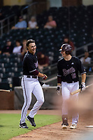 ASU Sun Devils center fielder Hunter Bishop (4) is congratulated by Trevor Hauver (18) after hitting his first home run of the night during an Instructional League game against the Texas Rangers at Surprise Stadium on October 6, 2018 in Surprise, Arizona. (Zachary Lucy/Four Seam Images)