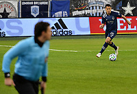 KANSAS, KS - DECEMBER 03: Roger Espinoza #15 of Sporting Kansas City dribbles the ball out of the box during a game between Minnesota United FC and Sporting Kansas City at Children's Mercy Park on December 03, 2020 in Kansas, Kansas.