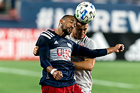FOXBOROUGH, MA - AUGUST 29: Teal Bunbury #10 of New England Revolution and Aaron Long #33 of New York Red Bulls battle for head ball during a game between New York Red Bulls and New England Revolution at Gillette Stadium on August 29, 2020 in Foxborough, Massachusetts.